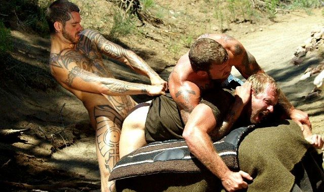Muscle guy yells as he gets tied down and raped