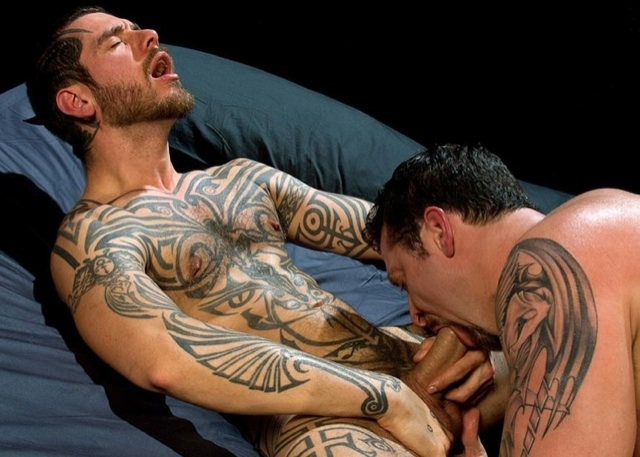 Logan McCree getting his tatted cock sucked