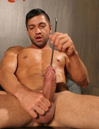 Dominc inserts a thick rod into his hard cock