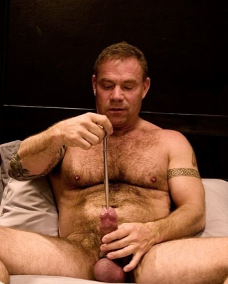 Beefy Luke Montana inserts a sounding rod into his hard cock
