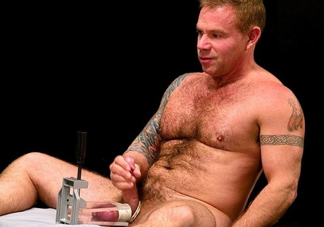 Luke Montana jerks off with his nuts in a vice