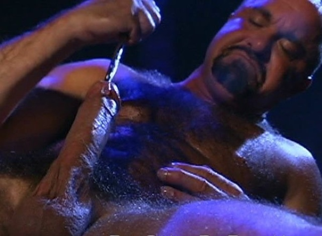 Steve pumps his cock with a thick sounding rod