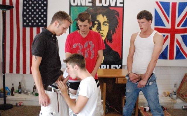 Travis on his knees servicing a bunch of his brothers cocks
