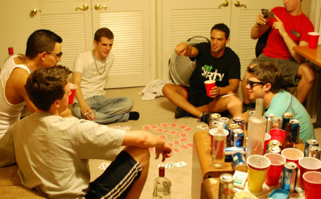 Frat boys playing cards and drinking