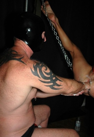 Masked top Hans Inya working his fist into a tight ass