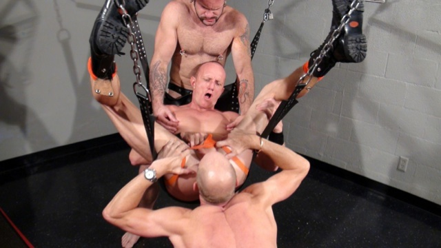 Mason Garet in the sling being worked over by Tober and Parker