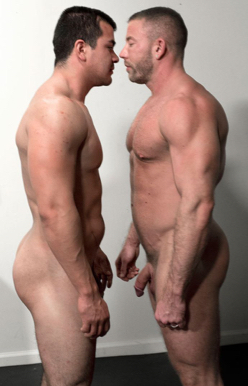 Two naked bodybuilders face off