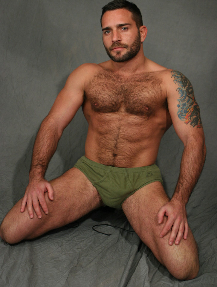 Hairy man on his knees wearing green briefs