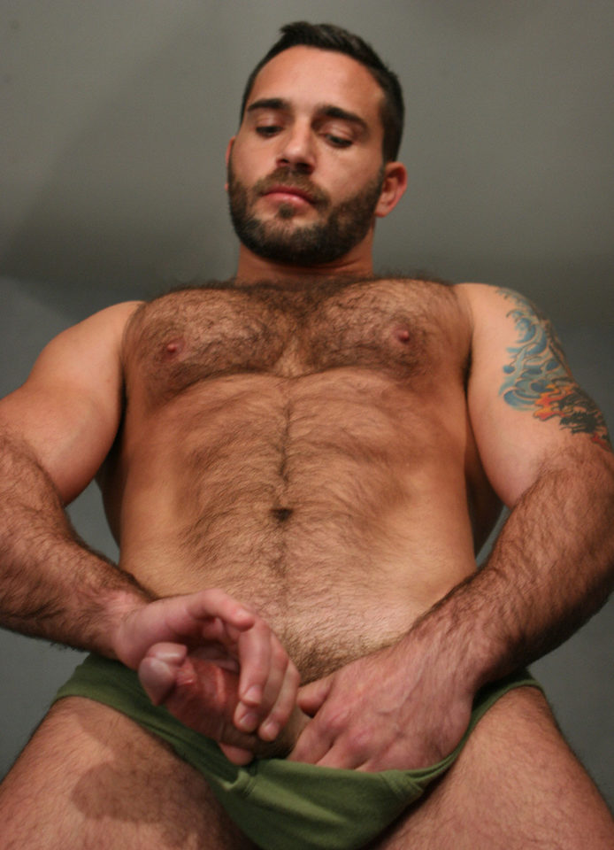 hairy, muscled guy stroking himself