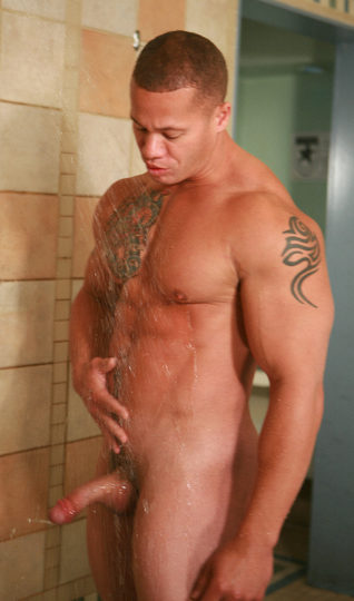 tattoed muscle hunk takes shower with hard cock