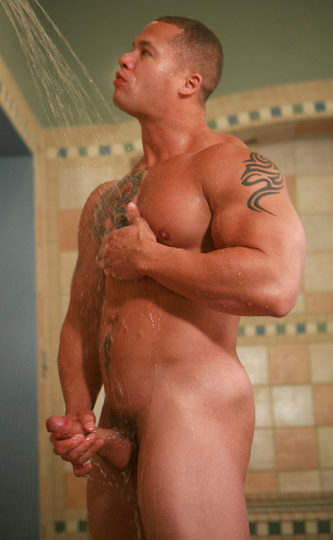 muscle hunk stroking big cock in the shower