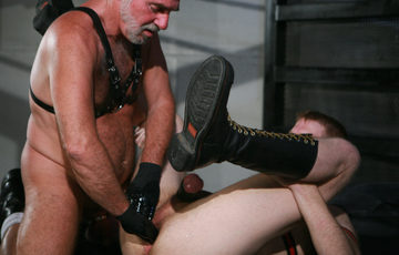 Leather Daddy fists boy hole