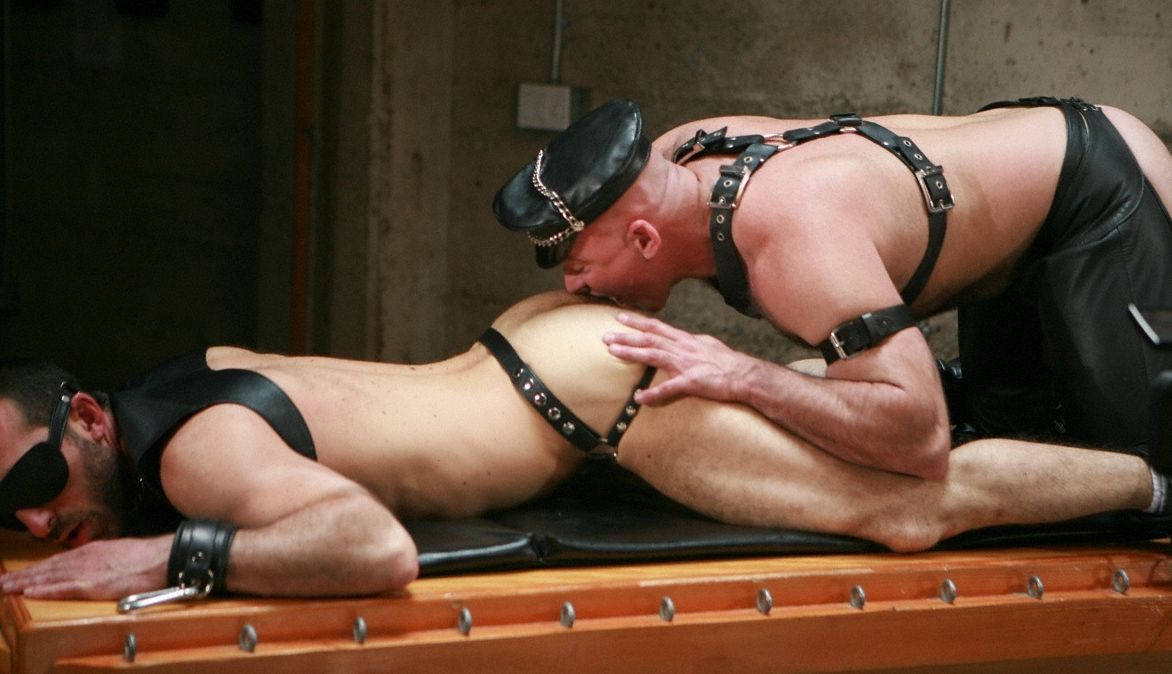 Blindfolded leather boy getting his ass eaten by Ray Stone