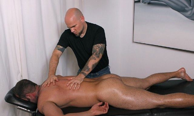 Hot inked masseuse working on Max\'s beefy back