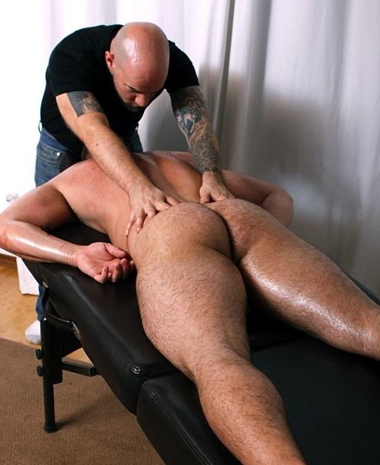 Masseuse working muscle bears back and beefy ass