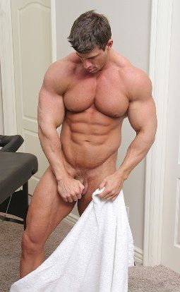 Ripped muscle boy undressing and stroking hard cock
