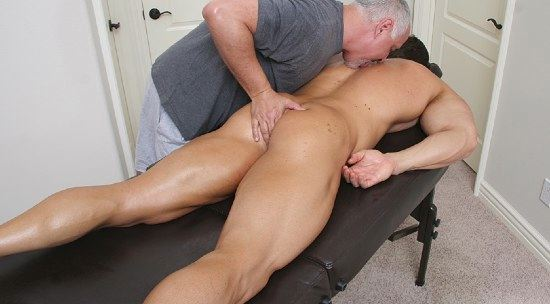 Shaved bodybuilder gets his ass played with