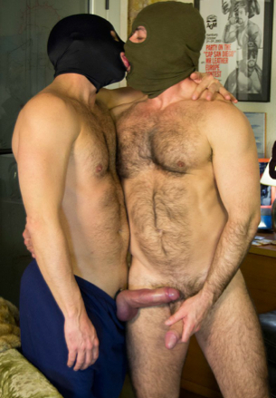 Two masked hairy guys kissing