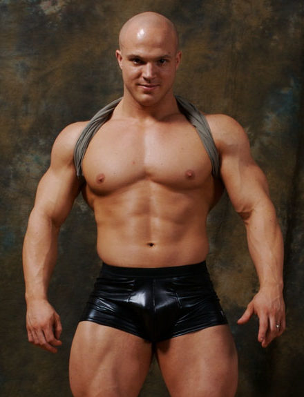 Hot young bodybuilder Kyle Stevens in rubber shorts