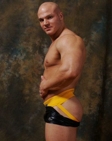 Hot young bodybuilder in a yellow jock