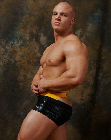 Cute young body builder in ruybber shorts and a jock