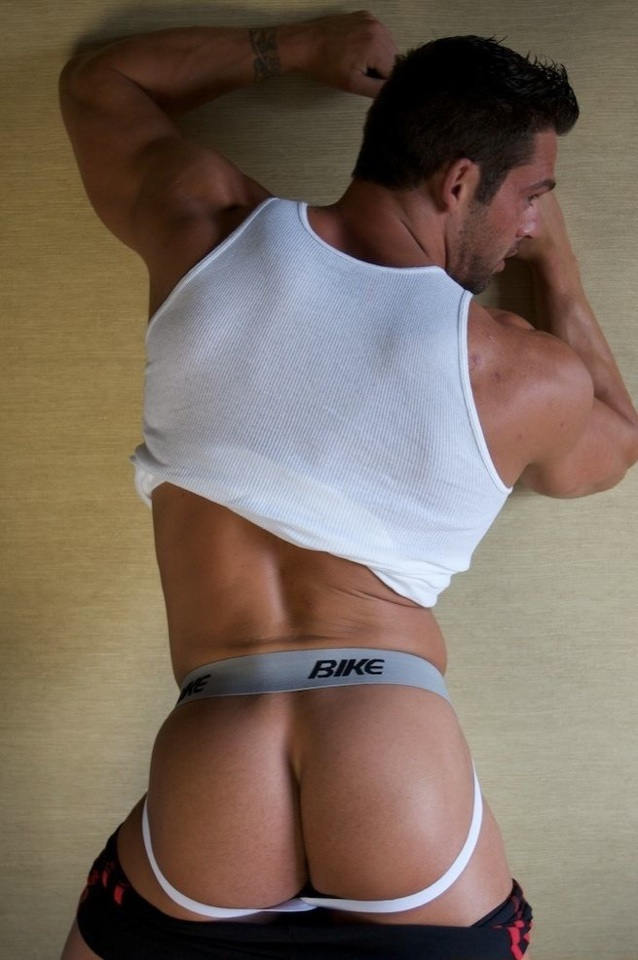 Scruffy muscle boy with bubble butt in jockstrap