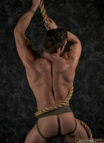 Body builder with perfect bubble ass wearing green jock