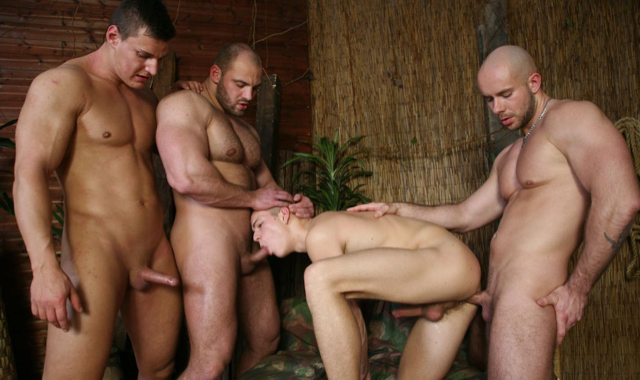 Three hot muscle guys spit roast a young twink