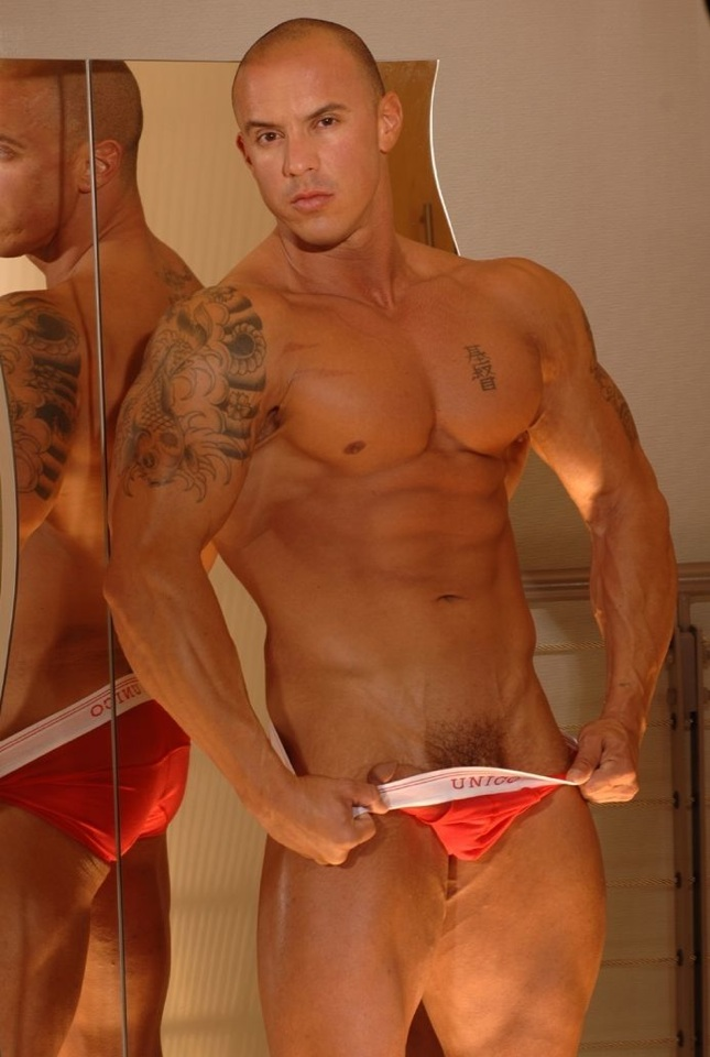 Tattooed bodybuilder Vin Marco shows off the head of his dick