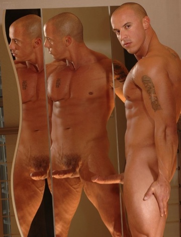 Vin Marco posing in front of a mirror with a hard cock