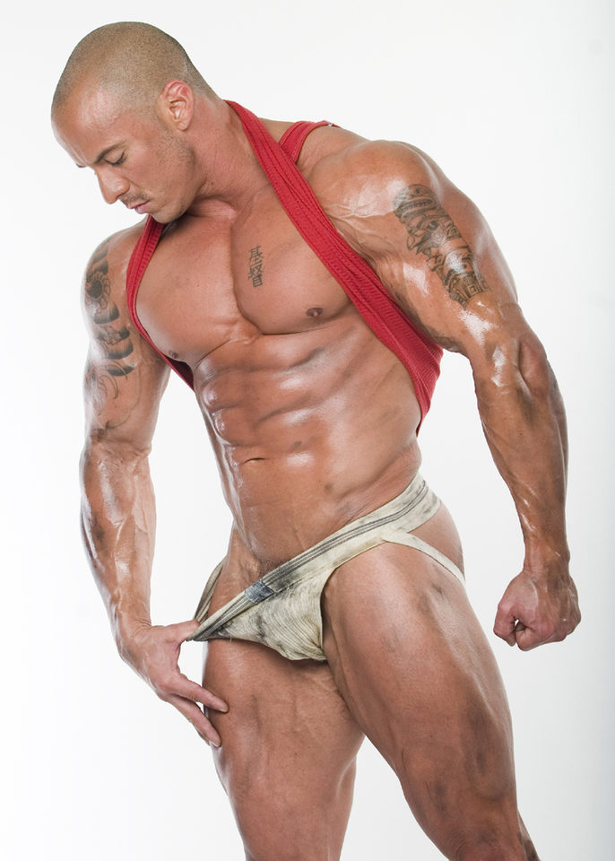 Vin Marco with stubbly head and dirty body and jockstrap
