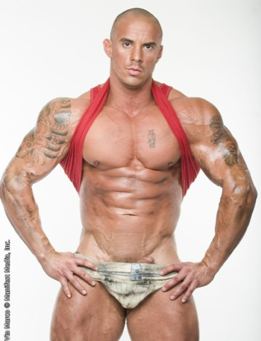 Beefy bodybuilder with the head of his dick peeking out from a dirty jock