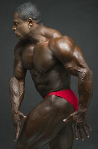 Ripped, competition ready black bodybuilder Sean Jones