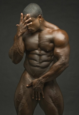 Perfect bodybuilder body - naked with his hand in front of his dick