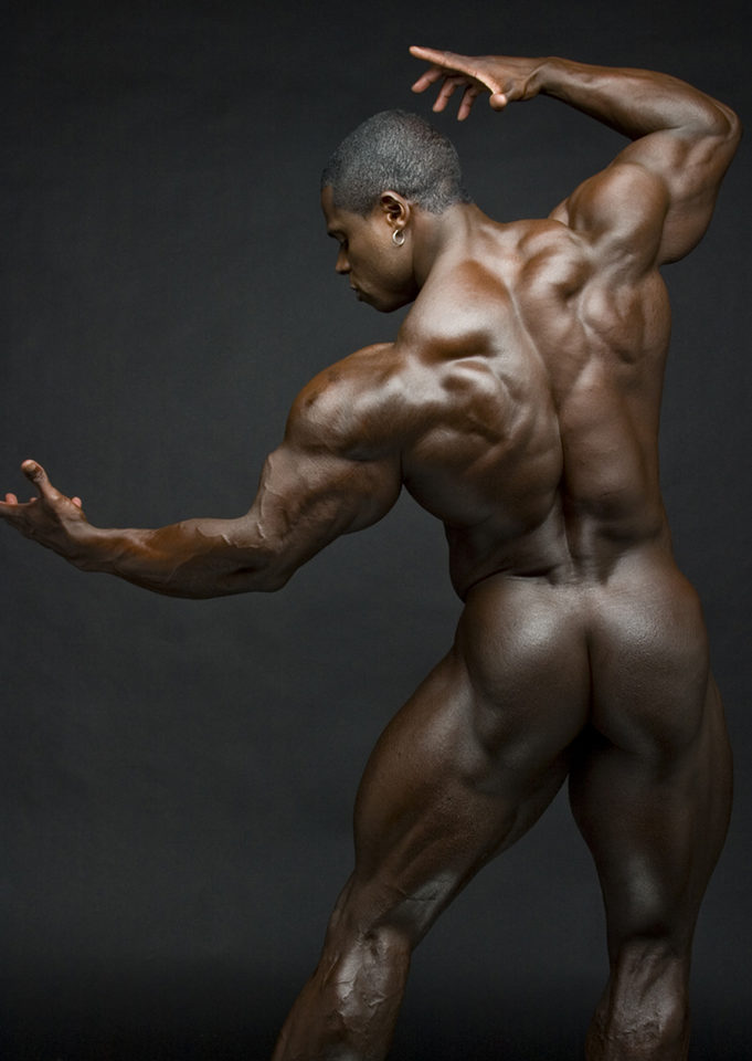 Sean Jones posing naked, showing his back and ass