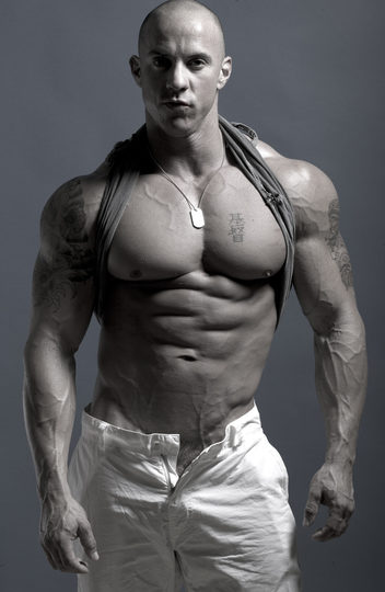 Ripped bodybuilder Vin Marco with his bad boy image complete with tattoos and a shaved head