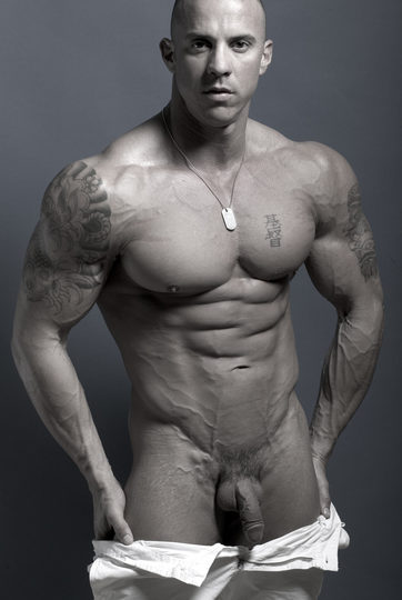 Stud bodybuilder with tats, huge arms, and a soft dick