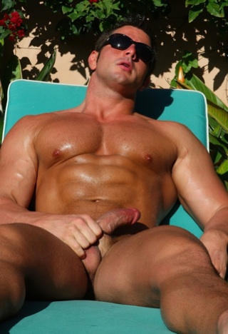 Frank Defeo tanning his abs and cock