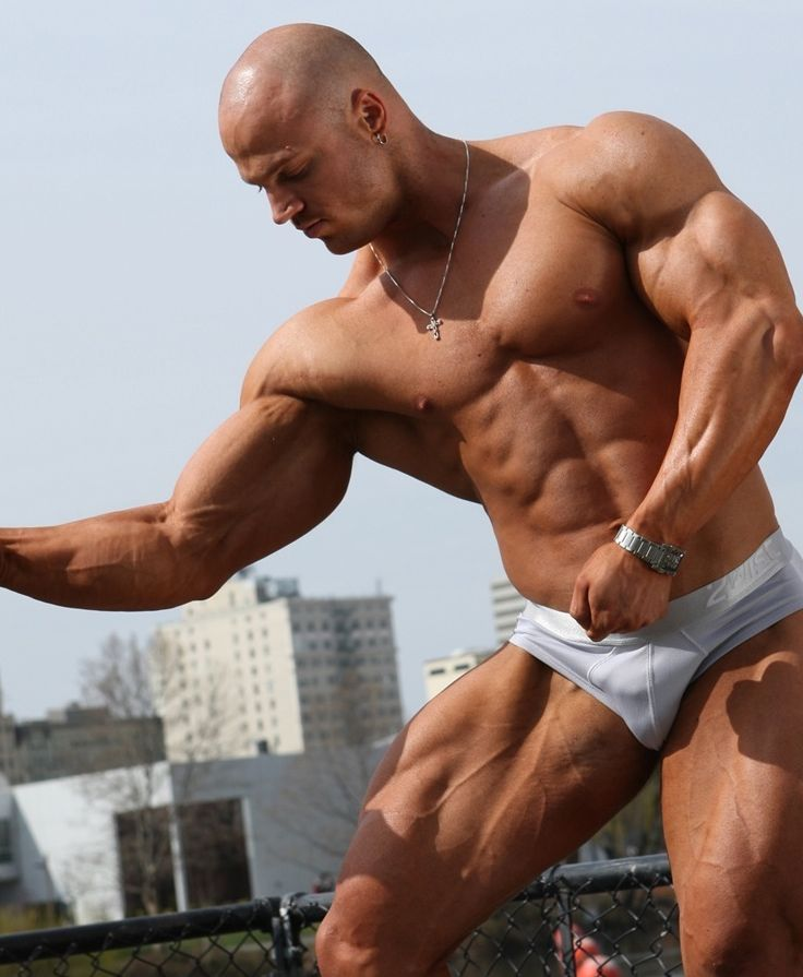 Watch Kyles muscles bulge as he flexes his big arms.