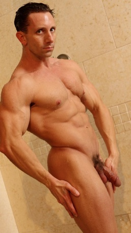 Aaron Austin naked in the shower bathing his muscular body