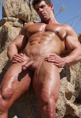 looking up at sexy muscle stud Zeb Atlas naked outside on a rock