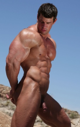 Rippped body builder Zeb Atlas flexes his arm and abs outside