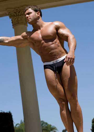 Sexy Muscle Hunk A-Bomb standing looking ripped