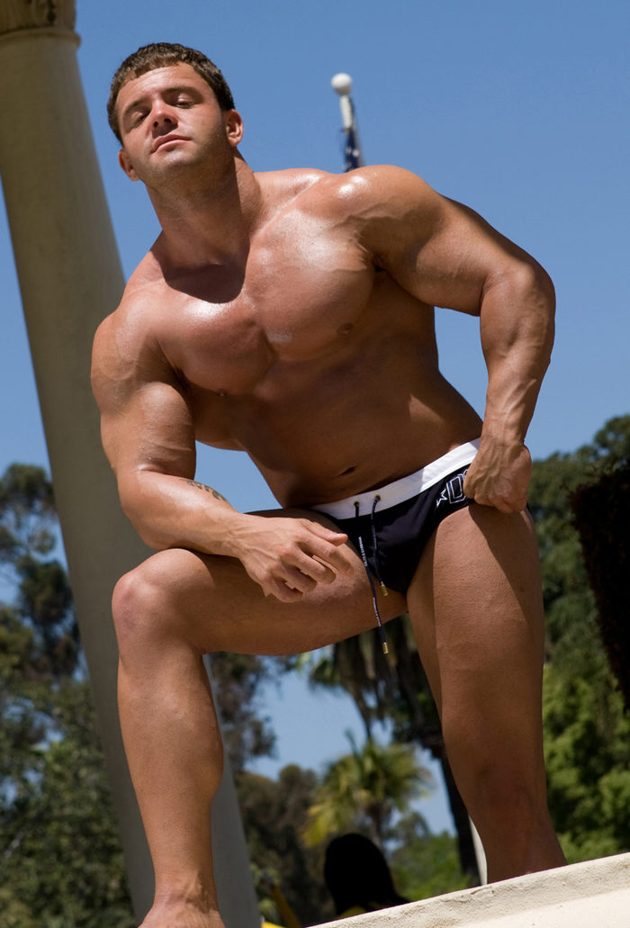 Body Builder A-bomb showing his muscle body in speedos outside
