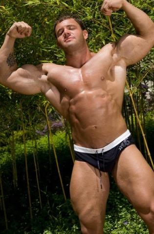 hot muscle stud A-Bomb shows off his huge arms
