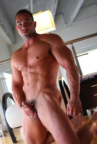 Ripped bodybuilder stroking hus cock