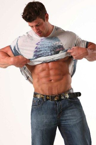 Ripped bodybuilder showing his ripped abs