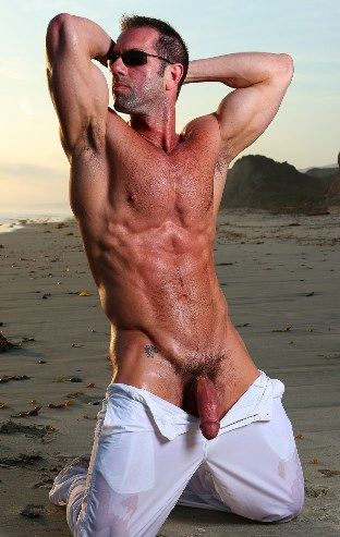 Muscle bear with huge cock wet on beach