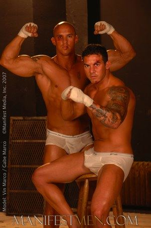 Tough tattooed muscle guys pose for the camera