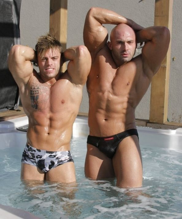 Jason and Sean pose outside in a hot tub